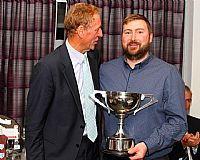 Rob Nixon collects the Senior Bowling Aggregate Trophy (while Mr Coney marvels at his beard)